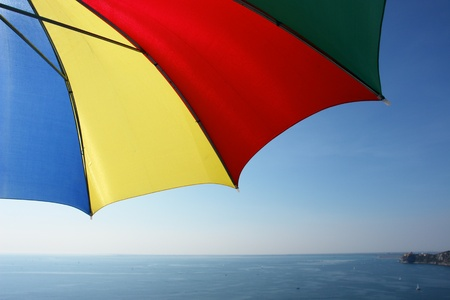 colorful parasol at the ocean photo
