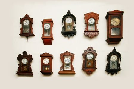 vespers: Old vintage clocks on a wall Stock Photo