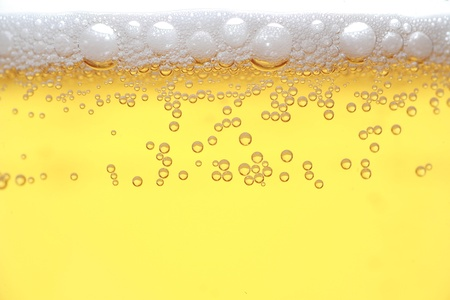 Detail of a beer in a glass with foam