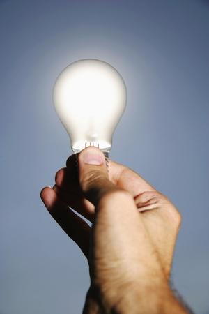 solarenergy: electric bulb against the sun as a symbol for solar energy