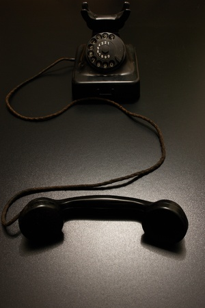 an old vintage telephone in dramatic lighting. photo