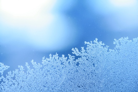 The patterns made by the frost on the window (hoarfrost background) Stock Photo