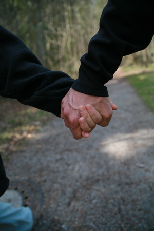 couple holding hands on a walk photo