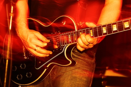 gig: closeup of an guitarist at a rock concert, motioneffect! Stock Photo