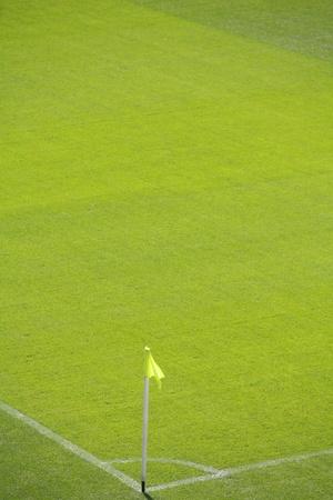 to make a corner kick at a football field photo