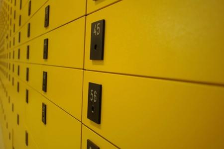 mailroom: yellow lock boxes very shallow DOF........... Stock Photo
