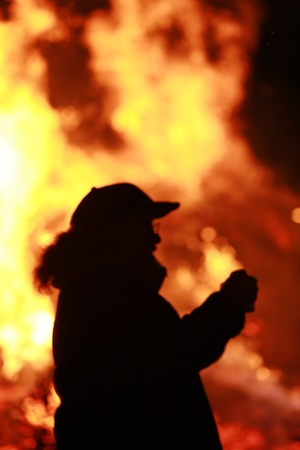arson: Close-up of some people coming out of fire Stock Photo
