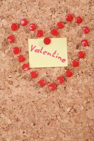 bulletinboard: a valentine heart made of thumb tacks on a corkboard Stock Photo