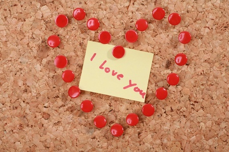 a valentine heart made of thumb tacks on a corkboard photo