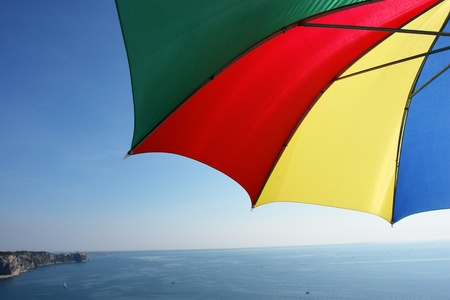 colorful parasol at the ocean on a sunny day photo