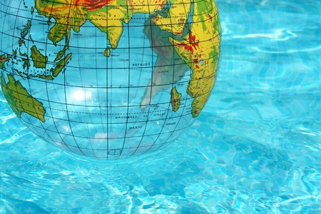 globe ball in the swimmingpool at as unny day photo