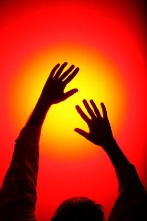 Dancing Hands reach the light photo