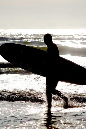 surfing at a nice beach outside at the sea photo
