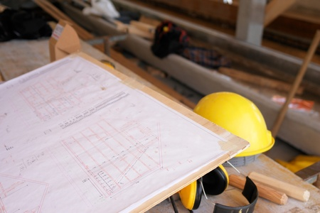erecting: close-up of a hardhat and a plan... Stock Photo