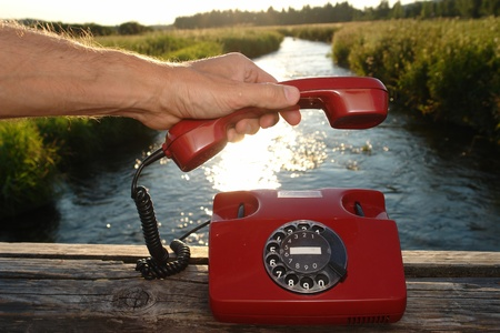 red phone in landscape Stock Photo - 14347556