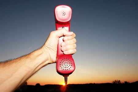 red phone in landscape Stock Photo - 14341057