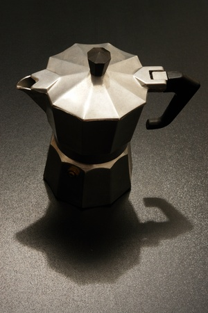 expresso: an expresso maker in dramatic lighting. Stock Photo