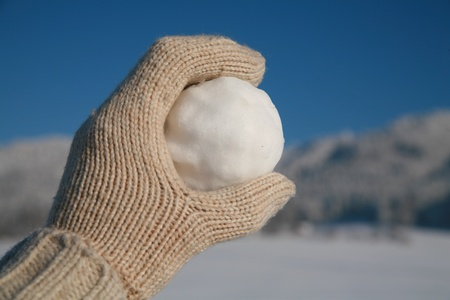 happy snow ball fight in winter time Stock Photo