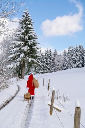 Santa Claus, Father Christmas in a beautiful winter landscape Stock Photo