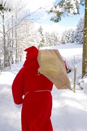 nicholas: Santa Claus, Father Christmas in a beautiful winter landscape Stock Photo
