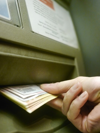 Finger using automatic teller keypad to enter pin number Stock Photo - 15975140