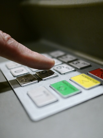 atm: Finger using automatic teller keypad to enter pin number Stock Photo