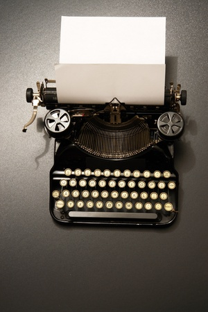 typewriter: a typewriter in dramatic lighting