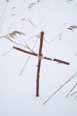 Cross in winterscene photo