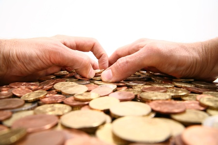grabbing all the money, hands grabbing coins isolated white background Stock Photo - 16257181
