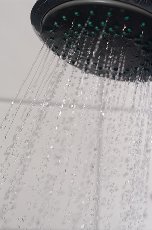 water drops falling from a shower indoors photo