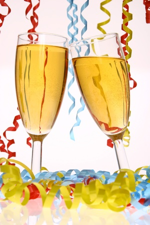 sylvester: two champagne glasses clink for new year on sylvester............