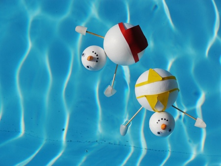 snowman beach vacation holidays from cold winter Stock Photo
