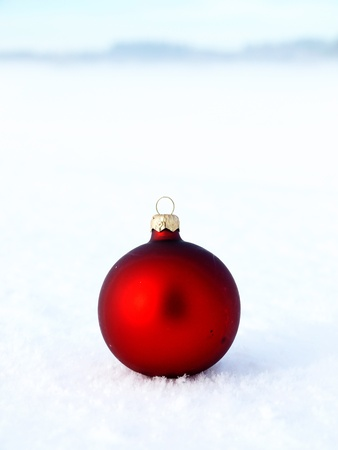 Christmas decoration outside in real snow during snowfall photo