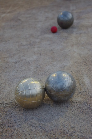 dross: Metal spheres for game in boccia on sand