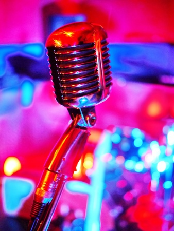 classic microphone with pinkt lighting on background Stock Photo - 17551225