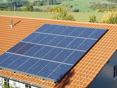 alternative energy source: solar cell on on roof producing electricity