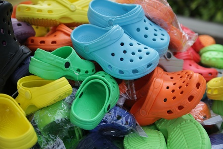 innumerable: colorful shoes or jootis or jutis on sale at a flea market Stock Photo