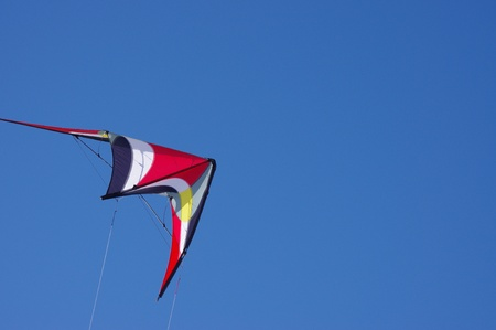 sport colorful stunt Kite in clear blue sky photo