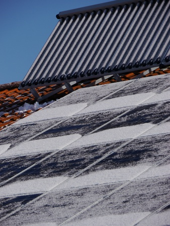 Solar panel on a roof and one for heating photo