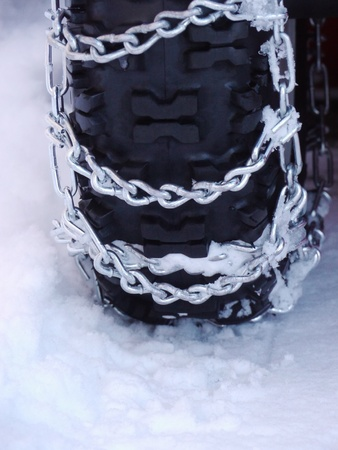 Snow chains outside at a wheel in winter Stock Photo - 17551503