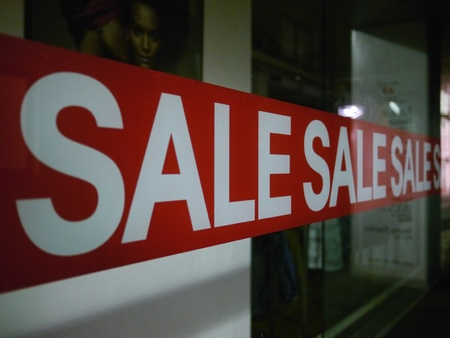 forsale: Sale sign on glass window of fashion boutique Stock Photo