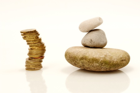 pepples: Coins and Pepples on white background as a symbol for financial balance Stock Photo