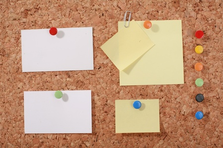 Several message papers pinned to cork board Stock Photo - 17552094