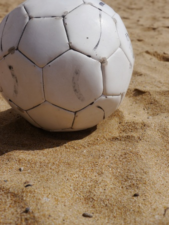 soccer ball on a beach in white leather photo