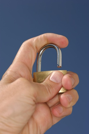 chainlinks: Hand holding padlock Stock Photo
