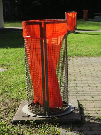 Orange trash bin out side Stock Photo - 18269608