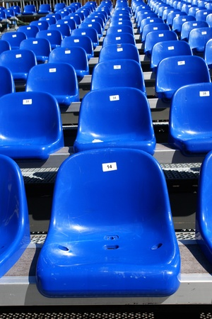 plactic: Rows of blue seats on modern stadium