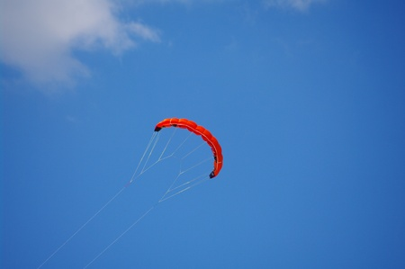 Colorful kite flying in the summer breeze photo
