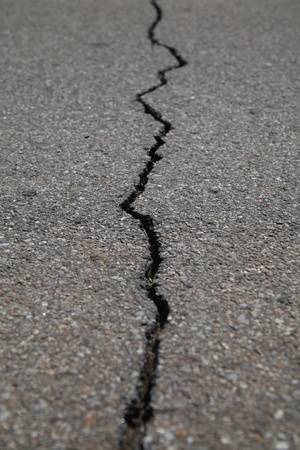 texture of tarmac road with cracks - abstract background photo
