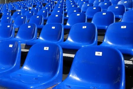 plactic: Rows of blue seats on modern stadium